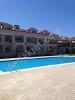 Fotoğraf Akbük de satilikyazlik dai̇re yüzme havuzlu...