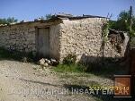 Fotoğraf Datça zeytincik mahallesinde eski taş ev
