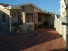Photo Two bedroom freestanding Home in Small complex...