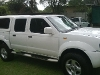 Photo 2007 Nissan Hardbody Double Cab with canopy